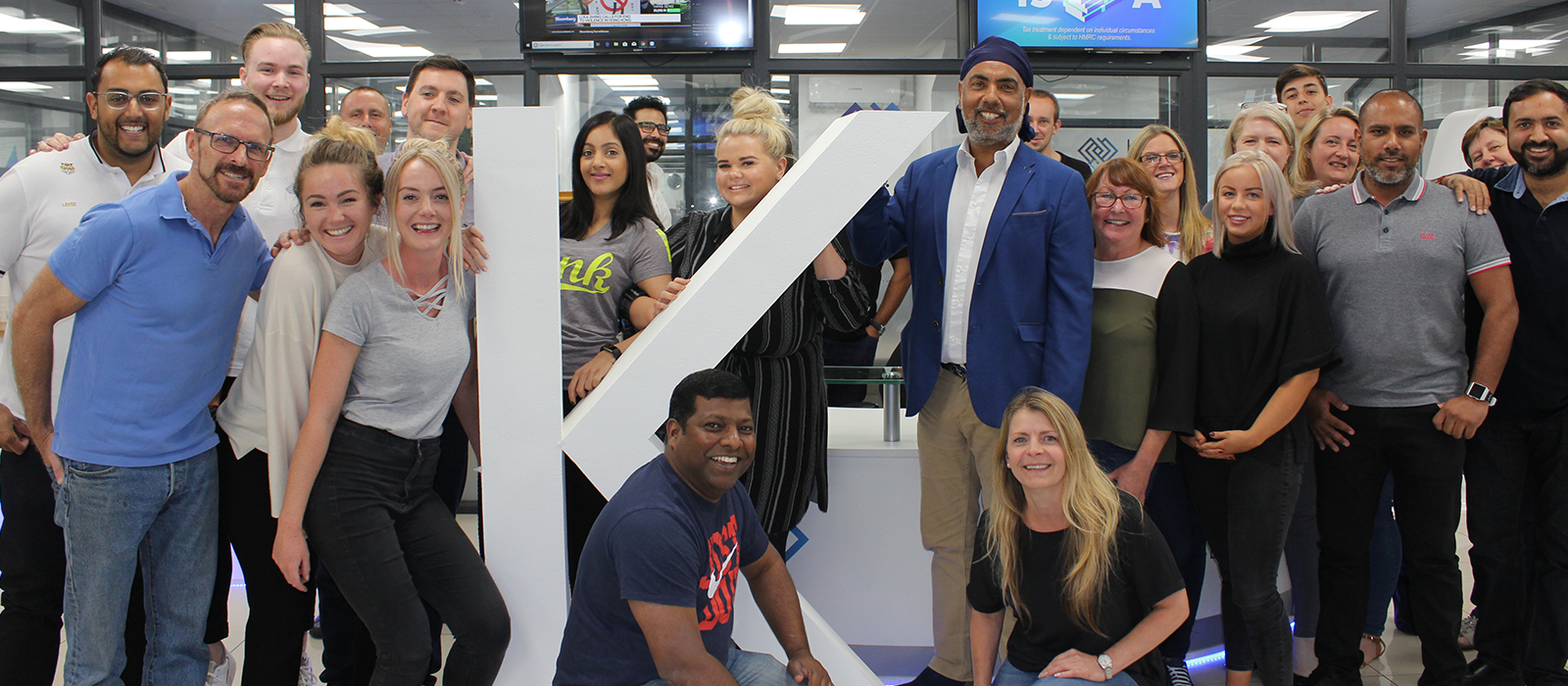 The Kuflink team posing with the big K.